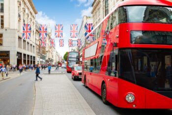 Photo of red busses on Oxford Street in London