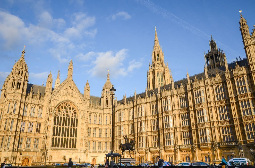 Photo of the Palace of Westminster, taken from the Old Palace Yard, showing its impressive neo-Gothic facade and the statue of Richard I.